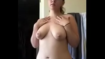 in front of mobile webcam she is liquidating.