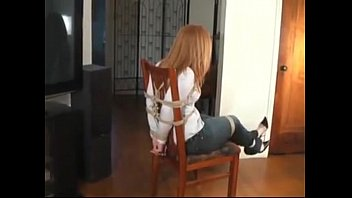 ultra-cute tiny teenager red-haired coerced strapped and ball-gagged.