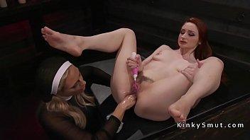 ash-blonde nun pokes lezzie with strap.