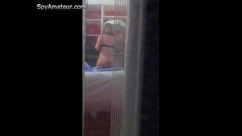 hidden cam peeping thru window with cougar disrobing.