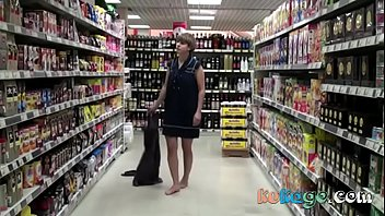 sizzling woman unclothes in the grocery.