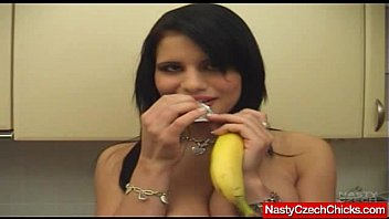 monstrous-jugged brown-haired plays with a banana