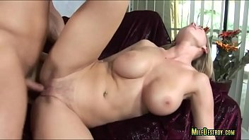 hefty-boobed blond cougar railing on couch