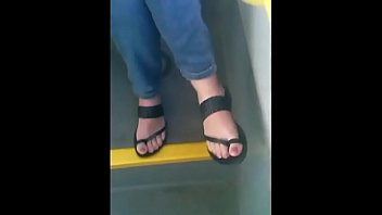 candid feet in sandals with active toes.