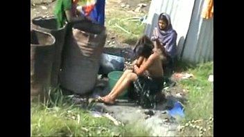 indian village ladies bathing nude in open caught.