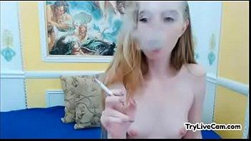teenager ash-blonde smocking on webcam at.
