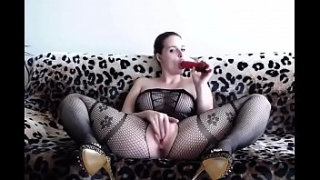supah hot dame dressed in a ebony bodystocking plays