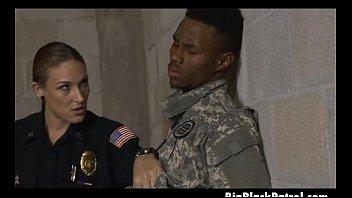 two damsel cops blowing on one good-sized ebony.