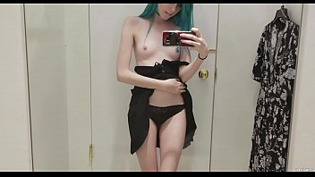 kinky punk teenage with blue hairs disrobing at.