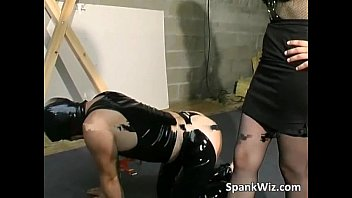 trussed dude gets his bootie spanked