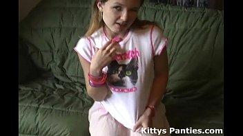 smallish teenage kitty in a uber-cute tiny pinkish mini-skirt