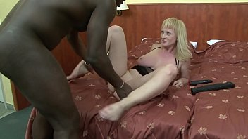 silver-blonde cockslut monik blows a lengthy ebony impaler.