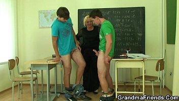 insane mature schoolteacher is banged by two wild pupils