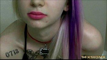 web cam woman puts on pretty pinkish lip.