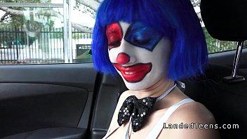 nubile in clown costume pulverizing outdoor.