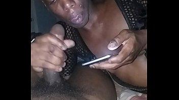 transgender princess throating fat ebony sausage while on smartphone