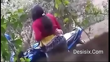 desi duo standing poke in forest