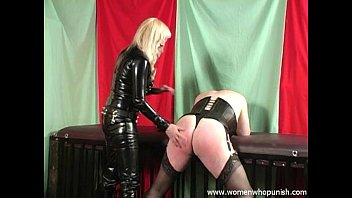 dame dominance spanking a crossdresser